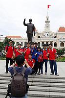 Graduate students near Ho Chi Minh statue<br />  - Ho Chi Minh City.