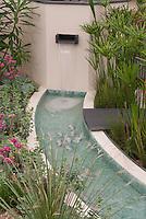 Waterfall in modern water garden