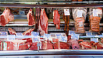 Spanish butcher displaying cuts of meat in glass fronted display unit. Santa Cruz Market, Tenerife, Canary Islands,