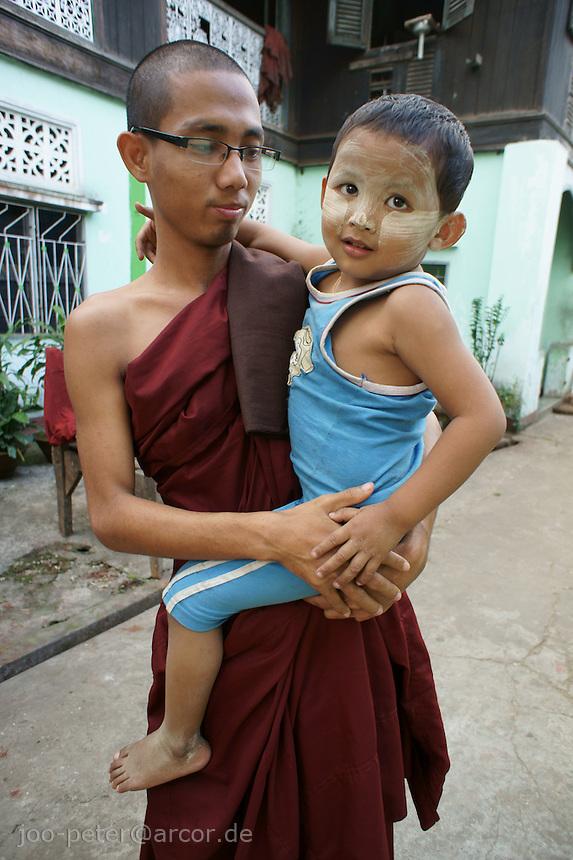 monk with child on his arm, Yangon, Myanmar, 2011