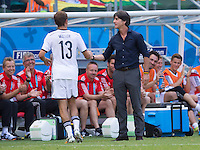 Thomas Muller shakes hands with Germany manager Joachim Low