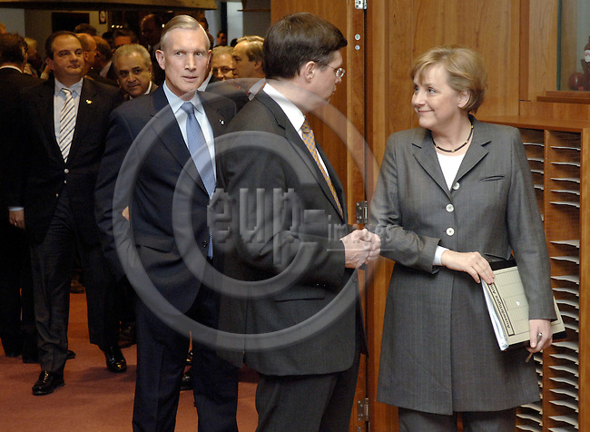 Brussels-Belgium - 23 March 2006---European Council, first day/meeting; here, Angela MERKEL (ri), Federal Chancellor of Germany, with Jan Peter BALKENENDE (ce), Prime Minister of The Netherlands, and Bernard R. BOT (le), Minister for Foreign Affairs of The Netherlands---Photo: Horst Wagner/eup-images