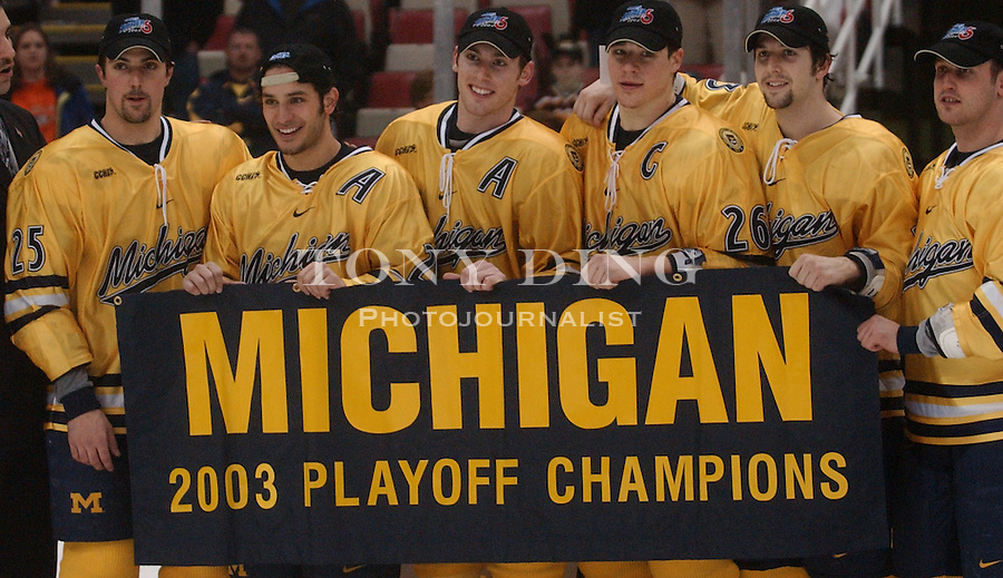Michigan Hockey seniors pose for a photo after they beat Ferris State (4-3) for the CCHA Conference Championship on Saturday, March 22, 2003 at Joe Louis Arena in Detroit, Mich (Tony Ding/Daily).