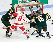 Peggy Wakeham (Vermont - 14), Holly Lorms (BU - 8), Roxanne Douville (Vermont - 34) watch the puck which hit iron and went wide. - The Boston University Terriers tied the visiting University of Vermont Catamounts 2-2 on Saturday, November 13, 2010, at Walter Brown Arena in Boston, Massachusetts.