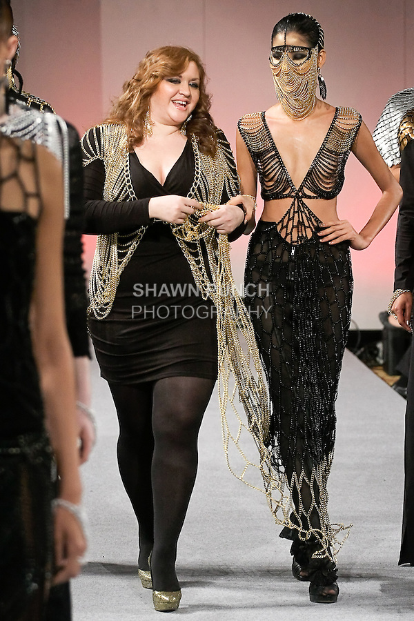 Fashion designer Laure Mae DeWitt, walks runway with Hoàng Thùy, Vietnam's Next Top Model Winner 2011, at the close of her LaureLuxe Metal Couture and Jewelry Fall 2012 collection fashion show, during Couture Fashion Week in New York, February 18, 2012.