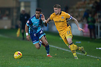 Paris Cowan-Hall of Wycombe Wanderers and Scot Bennett of Newport County race for the ball during the Sky Bet League 2 match between Newport County and Wycombe Wanderers at Rodney Parade, Newport, Wales on 22 November 2016. Photo by Mark  Hawkins.