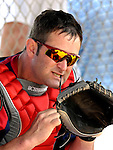 25 February 2007: Washington Nationals catcher Brian Schneider tightens the laces on his mitt during batting practice at their spring training facility in Viera, Florida.<br /> <br /> Mandatory Photo Credit: Ed Wolfstein Photo