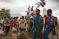 The tribe join the weekly market in Chatikana Orissa India