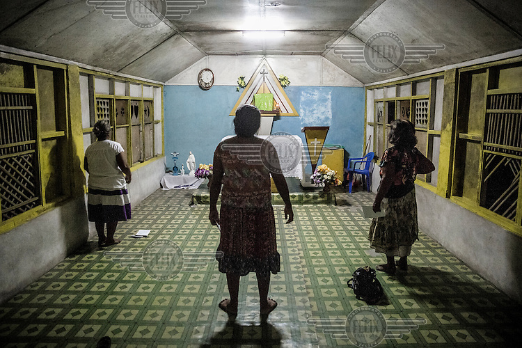 Women praying in a Catholic church.