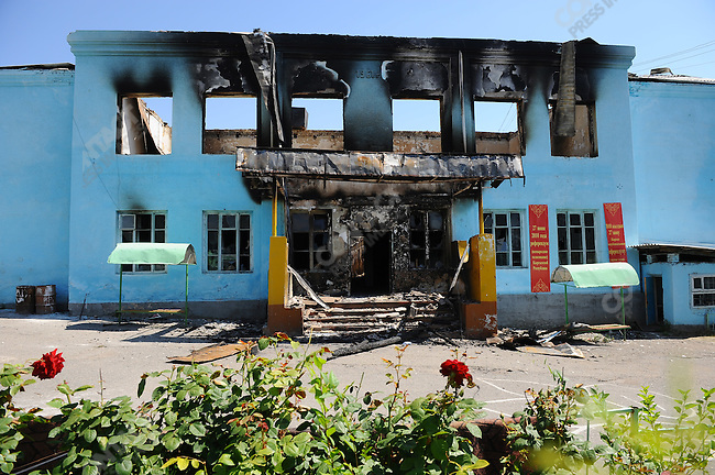 A burnt out school, largely for Uzbek children, destroyed in iner-ethnic violence, still had banners for next Sunday national referendum hanging from the wall, Osh, Kyrgyzstan, June 20, 2010