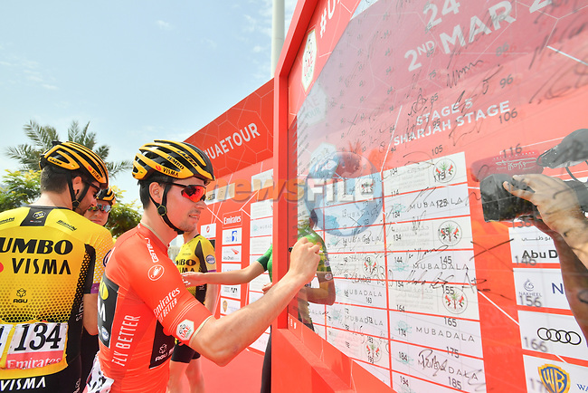 Race leader Primoz Roglic (SLO) Team Jumbo-Visma signs on before the start of Stage 5 of the 2019 UAE Tour, running 181km form Sharjah to Khor Fakkan, Dubai, United Arab Emirates. 28th February 2019.<br /> Picture: LaPresse/Massimo Paolone | Cyclefile<br /> <br /> <br /> All photos usage must carry mandatory copyright credit (© Cyclefile | LaPresse/Massimo Paolone)