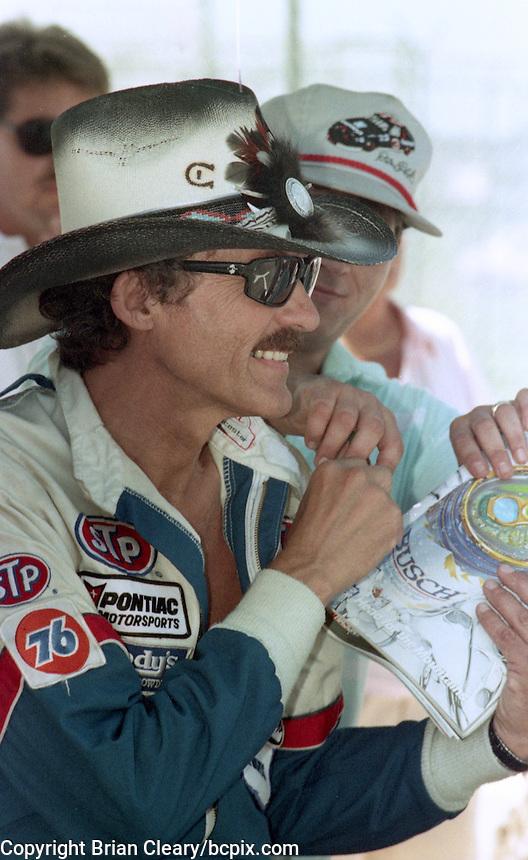 Richard Petty signs autographs before the Pepsi 400 at Daytona International Speedway, Daytona Beach, FL, July 7, 1990 (Photo by Brian Cleary/www.bcpix.com)
