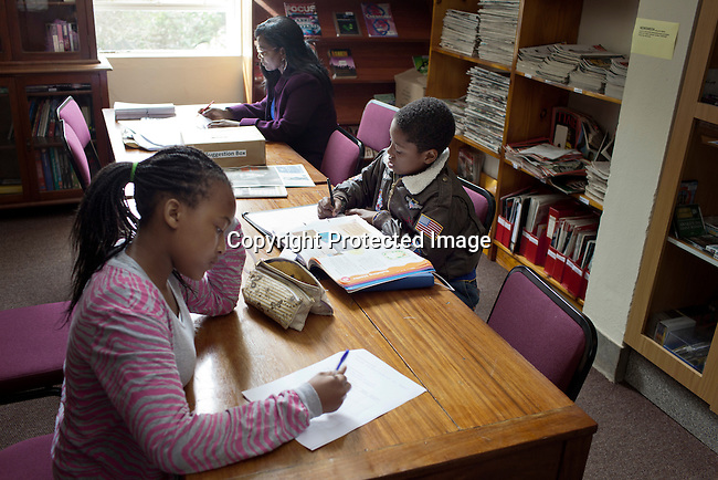 MBABANE, SWAZILAND - AUGUST 5: Students study in a library at Waterford Kamhlaba United World College of Southern Africa, a secondary school on August 5, 2013 in Mbabane, Swaziland. The school was funded in 1963 with 16 students during South Africa's Apartheid years. It's a multiracial school with 600 students with about 50 countries around the world. The majority are African students. (Photo by: Per-Anders Pettersson)