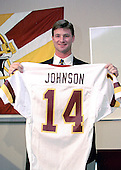 Newly acquired Washington Redskins quarterback Brad Johnson (14) holds up his new jersey as he appears at Redskins Park in Ashburn, Virginia for a press conference following his trade from the Minnesota Vikinga for a 1st & 3rd round draft choice in 1999 and a 2nd round draft choice in 2000 on February 16, 1999. <br /> Credit: Arnie Sachs / CNP