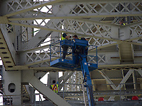 Canadian workers painting the original span of the Blue Water Bridges