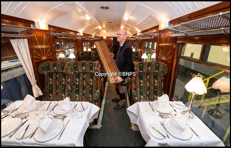 BNPS.co.uk (01202 558833)<br /> Pic: PhilYeomans/BNPS<br /> <br /> Final touches - Project Manager Chris Squires at work on the restored interior of the one of the Brighton Belle carriages at the workshops of WH Davis in Shirebrook, Derbys.<br /> <br /> It's the Brighton Swell...<br /> <br /> Back from the dead - The iconic Brighton Belle is being restored to its former glory - but with wider seats and aisles to accommodate today's plumper passenger. <br /> <br /> A small band of enthusiasts have spent 10 years and £6m returning the Pullman carriages to their former glory in an age that epitomised luxury and style.<br /> <br /> The unique carriages were individually designed in Art Deco style, and lined with stunning marquetry and plush furnishings.<br /> <br /> But although the original features have been lovingly conserved, restorers have been forced into some unavoidable changes to make the famous locomotive more compatible with the modern age of train travel.<br /> <br /> The original 2/2 seating plan has been adjusted to wider 2/1 to allow more room for the 21st century posterior, and USB ports, heaters and low voltage LED lighting have also been added.<br /> <br /> The 5BEL Trust now hope the four bespoke electric carriages will be able to run on the UK mainline for the first early next year - 48 years after it went out of service.