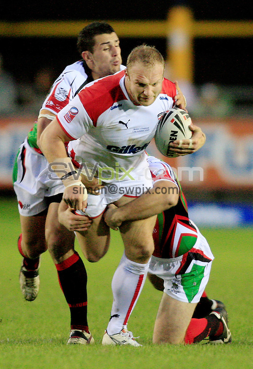 Pix: Chris Mangnall/SWpix.com, Rugby League, Gillett Fusion International 17/10/09 Wales v England....picture copyright>>Simon Wilkinson>>07811267 706>>....Wales's Ben Flower Neil Budworth tackles England's Garreth Carvell