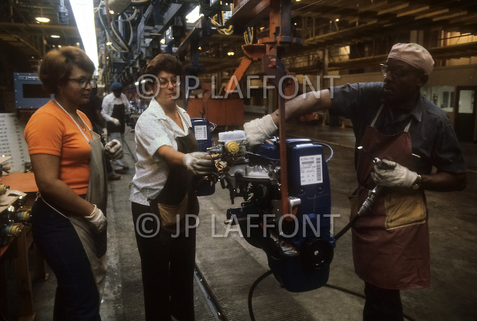 Detroit, U.S.A, December, 1980. Ford Escort motor assembly line inside the Ford Rouge Factory. Due to the gasoline crisis, the US manufacturer is using a smaller engine for the fisrt time.