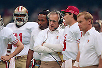 NEW ORLEANS, LA - Head coach George Seifert of the San Francisco 49ers coaches his team and talks with Steve Young during Super Bowl XXIV against the Denver Broncos at the Superdome in New Orleans, Louisiana in January of 1990. Photo by Brad Mangin.