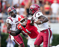 ATHENS, GA - OCTOBER 12: Dakereon Joyner #7 of the South Carolina Gamecocks straight arms Divaad Wilson #1 of the Georgia Bulldogs during a game between University of South Carolina Gamecocks and University of Georgia Bulldogs at Sanford Stadium on October 12, 2019 in Athens, Georgia.