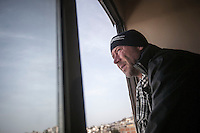 Dimitri Bontinck, a 39 years old belgium watchs towards Syria from a window at his hotel room in Kilis border town as he prepares himself to enter into Syria in his attemp to find out his son, a youth belgium who has turned himself into a Islamic fighter who is battling Syrian government army beside radical Muslim groups at the northern of Syria.