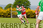 Mikey Geaney Dingle gets to grips with Mike Burke Milltown during their County SFC round 1 game in Killorglin on Sunday