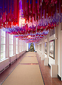 """The 2016 White House Christmas decorations are previewed for the press at the White House in Washington, DC on Tuesday, November 29, 2016. Pictured along the East Colonnade are more than 7,500 strands of ribbon in a myriad of colors hanging with sparkling crystal ornaments leading to the Booksellers.  The first lady's office released the following statement to describe those decorations, """"This year's holiday theme, 'The Gift of the Holidays,' reflects on not only the joy of giving and receiving, but also the true gifts of life, such as service, friends and family, education, and good health, as we celebrate the holiday season.""""<br /> Credit: Ron Sachs / CNP"""