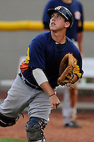 Catcher Brett Clements (6) of the Greeneville Astros warms up before a game against the Bristol Pirates on Saturday, July 26, 2014, at DeVault Memorial Stadium in Bristol, Virginia. Greeneville won, 4-0 in Game 2 of a doubleheader. (Tom Priddy/Four Seam Images)