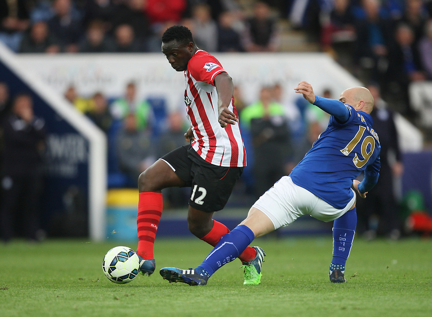 Southampton's Victor Wanyama (L) is fouled by Leicester City's Esteban Cambiasso<br /> <br /> Photographer Jack Phillips/CameraSport<br /> <br /> Football - Barclays Premiership - Leicester City v Southampton - Saturday 9th May 2015 - King Power stadium - Leicester<br /> <br /> &copy; CameraSport - 43 Linden Ave. Countesthorpe. Leicester. England. LE8 5PG - Tel: +44 (0) 116 277 4147 - admin@camerasport.com - www.camerasport.com