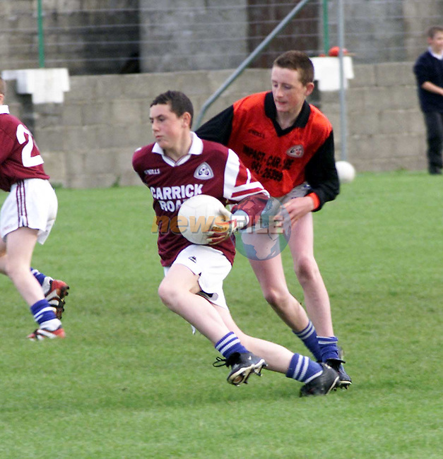 Action from na Gail and Naomh Martin at Dromiskin.Picture Paul Mohan Newsfile