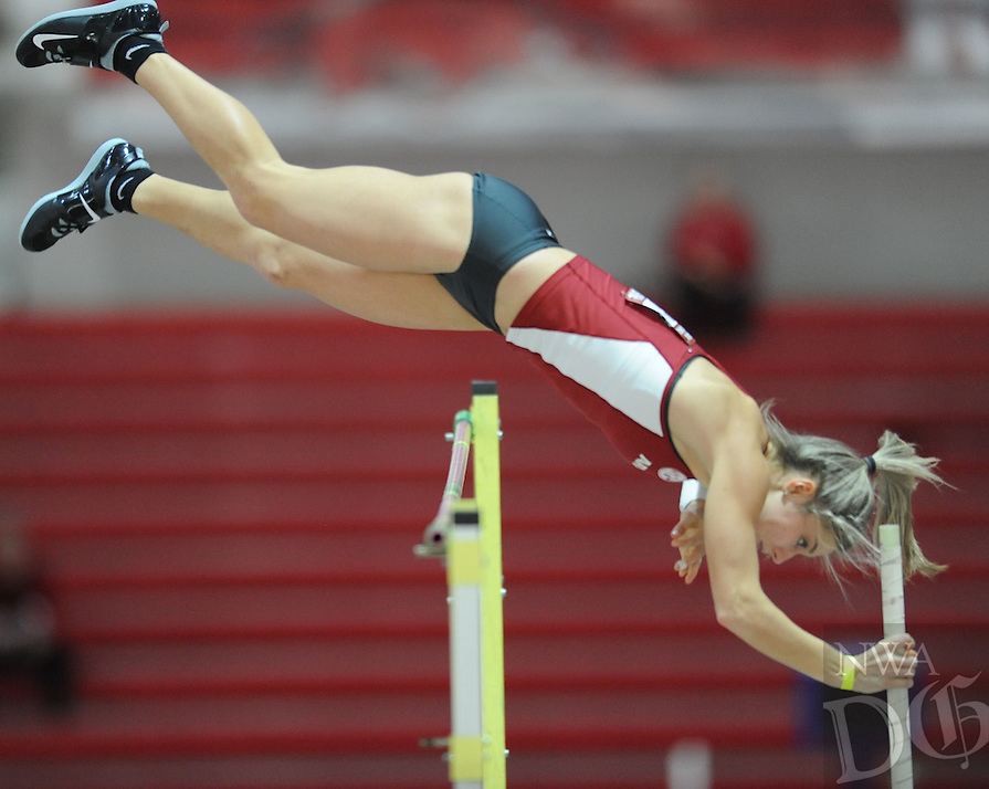 NWA Democrat-Gazette/ANDY SHUPE<br />Victoria Weeks of Arkansas clears the bar Friday, Jan. 27, 2017, during the pole vault competition in the Razorback Invitational in the Randal Tyson Track Center in Fayetteville. Visit nwadg.com/photos to see more photographs from the meet.