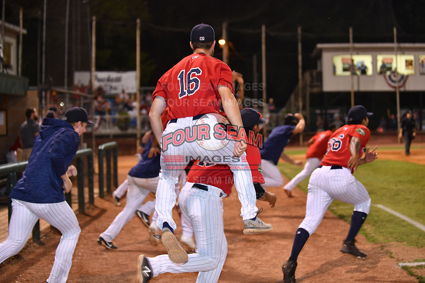 Elizabethton Twins pitcher Austin Schulfer (16) celebrates with his teammates after winning the Appalachian League Championship Series against the Princeton Rays 2-1 at Joe O'Brien Field on September 5, 2018 in Elizabethton, Tennessee. (Tony Farlow/Four Seam Images)