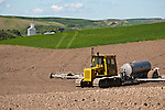 c. 2005 Caterpillar D5B crawler with spray unit on a plowed field in Washington's Palouse.