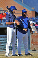 Asheville Tourists manager Fred Ocasio #28 talks with left fielder Francisco Sosa #29 before an at bat during a game against the West Virginia Power at McCormick Field on April 13, 2013 in Asheville, North Carolina. The Power won the game 14-9. (Tony Farlow/Four Seam Images).