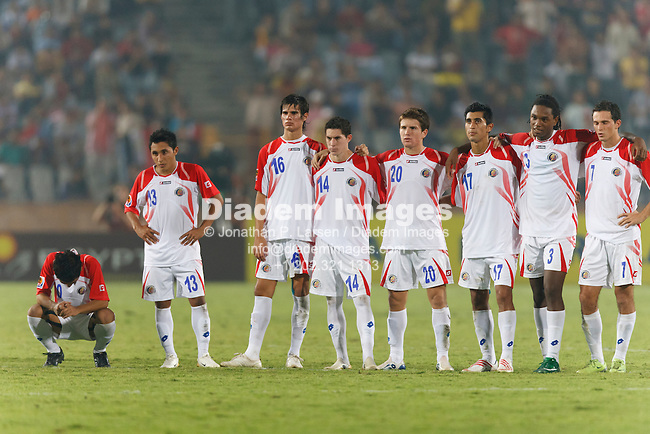 CAIRO - OCTOBER 16:  Costa Rican players react to a missed penalty kick against Hungary during the shoot out to determine the 2009 FIFA U-20 World Cup third place winner at Cairo International Stadium October 16, 2009 in Cairo, Egypt.  Hungary defeated Costa Rica on the penalties.  L-r:  Diego Estrado, Allen Geuvara, Carlos Hernandez, Bryan Oviedo, Esteban Luna, Josue Martinez, Roy Smith, Marcos Urena.  (Photograph by Jonathan P. Larsen)