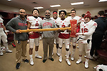Wisconsin Badgers wide receivers celebrates with the Paul Bunyan Axe in the locker room after an NCAA College Big Ten Conference football game against the Minnesota Golden Gophers Saturday, November 25, 2017, in Minneapolis, Minnesota. The Badgers won 31-0. (Photo by David Stluka)