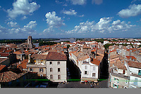 City overview of Arles, France, red-roofed buildings and Rhone River, France