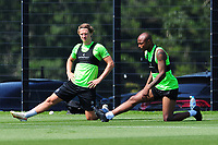 (L-R) George Byers and Andre Ayew of Swansea City in action during the Swansea City Training at The Fairwood Training Ground in Swansea, Wales, UK. Thursday 25th Junes 2020