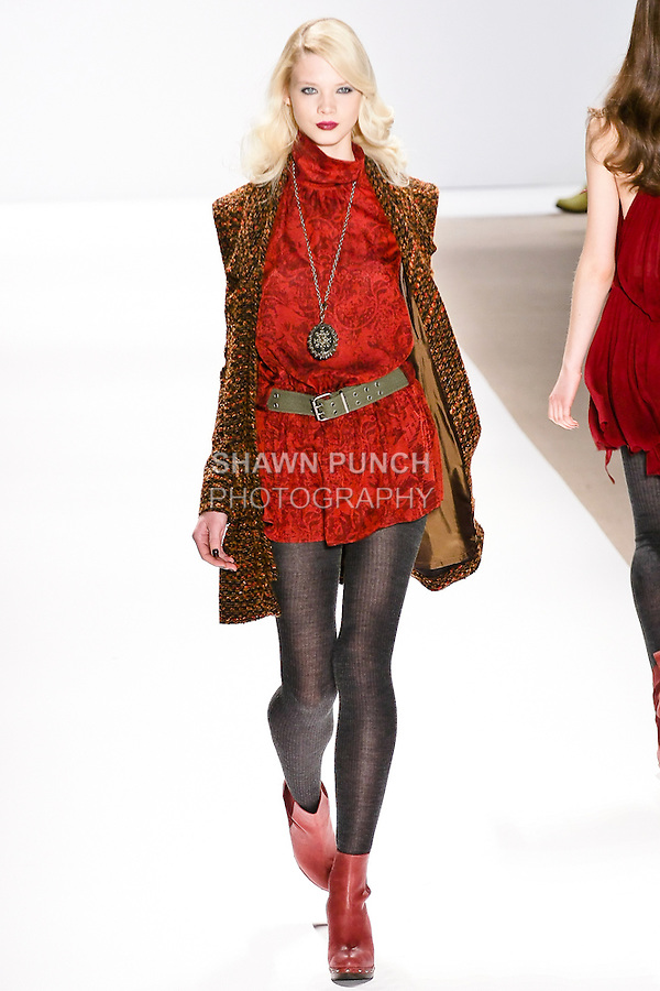 Model walks the runway in a copper tweed coat, and cinnamon print dress, by Nanette Lepore, for her Nanette Lepore Fall 2010 collection fashion show, during Mercedes-Benz Fashion Week Fall 2010.
