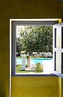 View through a square window to the outdoor swimming pool