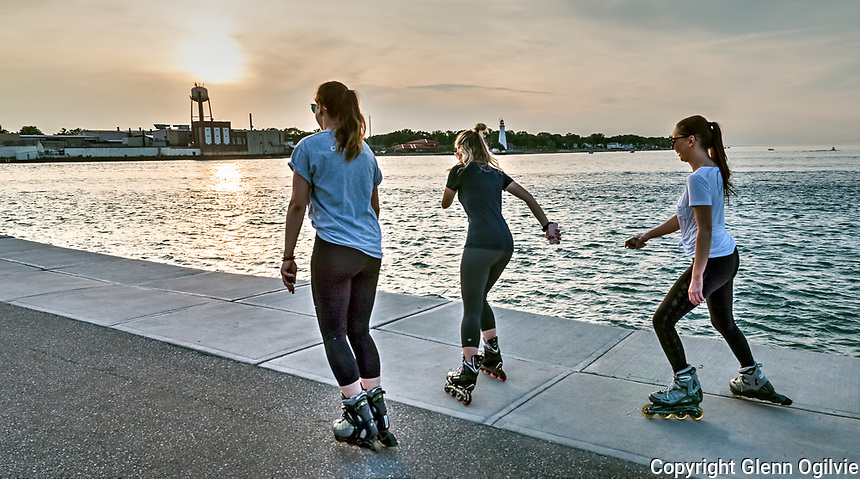 Kate Shepherd, white, of Corunna, Kaitlyn McNally, black, of Petrolia and Victoria Racine, of Sarnia, cool off along the Lake Huron-St. Clair River walk. The three spent a couple hours roller blading and enjoying the cool,refreshing breeze off the water while getting in some exercise.