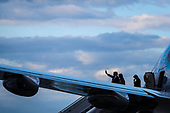 United States President Donald J. Trump with first lady Melania Trump and his son Barron Trump waves as he arrive aboard Air Force One in Andrews Air Force Base, Maryland, as he returns from Mar-a Lago in Palm Beach, Florida on April 21, 2019.<br /> Credit: Oliver Contreras / Pool via CNP
