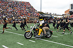 Former Wake Forest Demon Deacons great Aaron Curry rides on the back of the Demon Deacon mascot's motorcycle as he leads the team on to the field prior to the game against the Clemson Tigers at BB&T Field on October 6, 2018 in Winston-Salem, North Carolina. the Tigers defeated the Demon Deacons 63-3. (Brian Westerholt/Sports On Film)