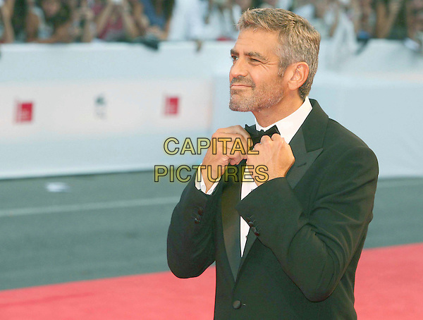 "GEORGE CLOONEY .""Michael Clayton"" premiere screening, .64th Venice Film Festival, Italy, 31st August 2007..La Biennale di Venezia half length black bow tie beard stubble grey hair tuxedo suit hands adjusting funny.CAP/OME.©Luca Ghidoni/Omega/Capital Pictures."