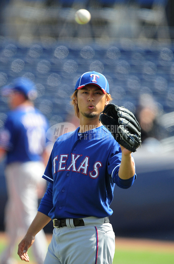 Mar. 7, 2012; Peoria, AZ, USA; Texas Rangers pitcher Yu Darvish in the second inning against the San Diego Padres at Peoria Stadium.  Mandatory Credit: Mark J. Rebilas-.