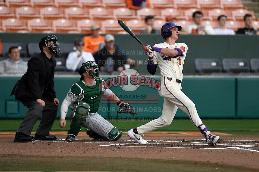 Shortstop Logan Davidson (8) of the Clemson Tigers bats in a game against the Charlotte 49ers on Monday, February 18, 2019, at Doug Kingsmore Stadium in Clemson, South Carolina. The catcher is Harris Yett and the umpire is Zach Neff. Clemson won, 7-6. (Tom Priddy/Four Seam Images)