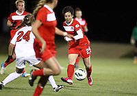BOYDS, MARYLAND - April 06, 2013:  Diana Weigel (24) of The Washington Spirit slips the ball away from Danielle Colaprico (24) of the University of Virginia women's soccer team in a NWSL (National Women's Soccer League) pre season exhibition game at Maryland Soccerplex in Boyds, Maryland on April 06. Virginia won 6-3.