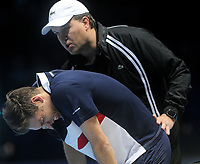 Nicolas Mahut grimacing in pain while being checked over by a medic after having a fall<br /> <br /> Photographer Hannah Fountain/CameraSport<br /> <br /> International Tennis - Nitto ATP World Tour Finals Day 2 - O2 Arena - London - Monday 12th November 2018<br /> <br /> World Copyright &copy; 2018 CameraSport. All rights reserved. 43 Linden Ave. Countesthorpe. Leicester. England. LE8 5PG - Tel: +44 (0) 116 277 4147 - admin@camerasport.com - www.camerasport.com