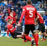 16.03.2019 Rangers v Kilmarnock: Stuart Findlay goes in two footed on Steven Davis