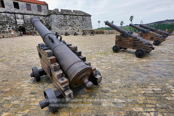 TH0329-D. Canons in front of the Castillo de la Real Fuerza. Completed in 1577 and influenced by Spanish Renaissance architecture, this castle is one of the oldest European defensive structures in the Americas. Havana, Cuba.<br /> Photo Copyright &copy; Brandon Cole. All rights reserved worldwide.  www.brandoncole.com